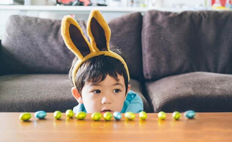 Kid with Easter eggs