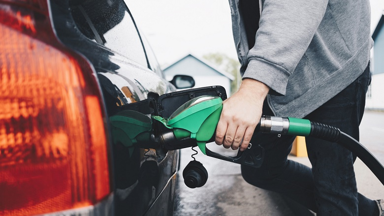 Photo of car being filled at petrol pump