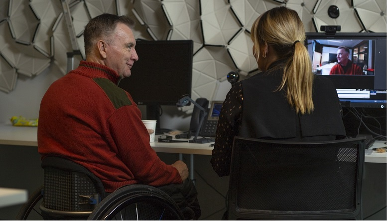 Man in wheelchair using technology in the CBA Innovation Lab