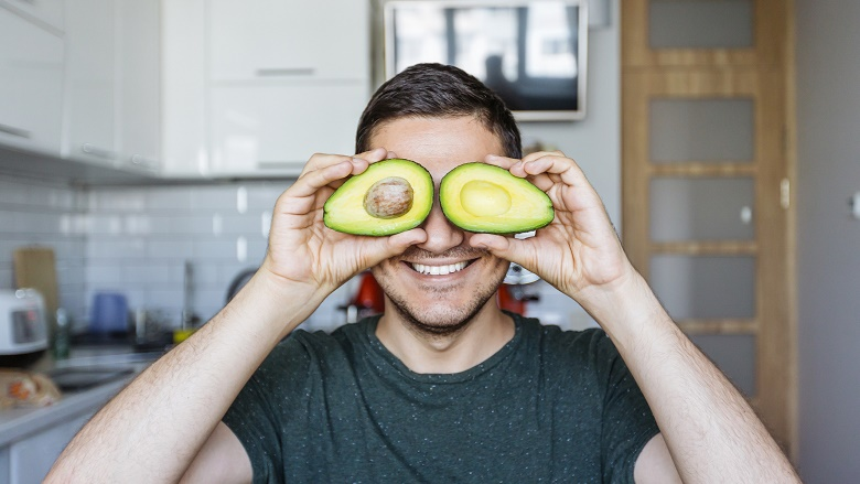 man with avocados