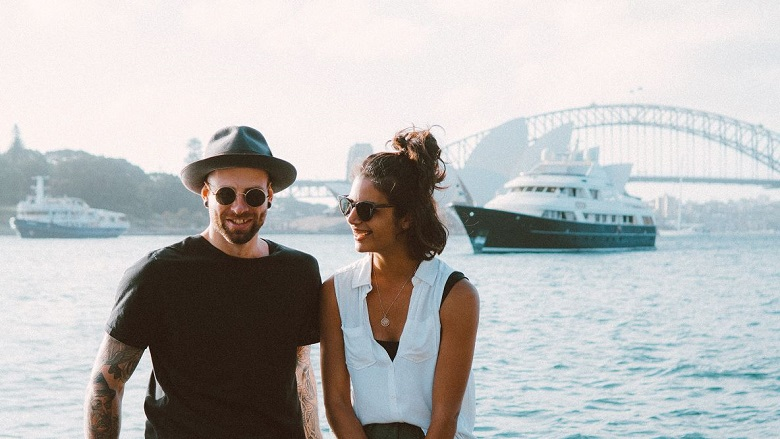 couple in front of Sydney harbour and bridge