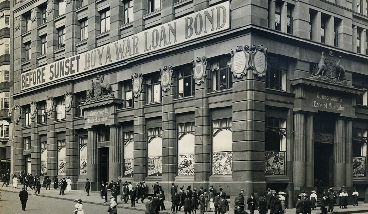CBA building with war bond advertising
