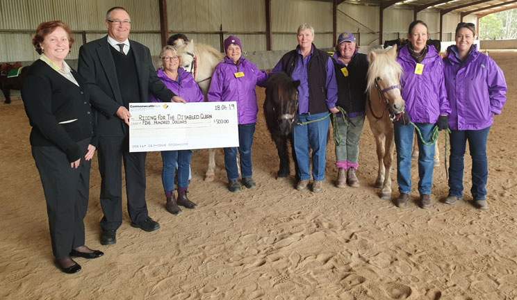 Noel Ottoway (CommBank) with staff of Goulburn Riding for the Disabled