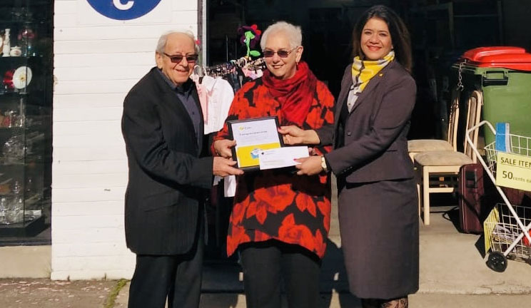 CBA Branch Manager Ruby presentingt the cheque to Lions members Pauline and Don, outside the Op Shop in Burwoord Village