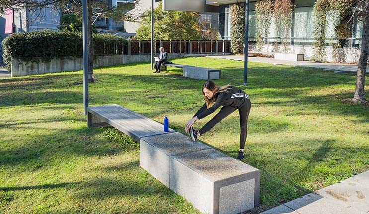 woman exercising outside at CommBank