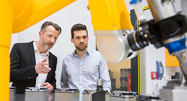 A businessman demonstrating robotic technology to a client