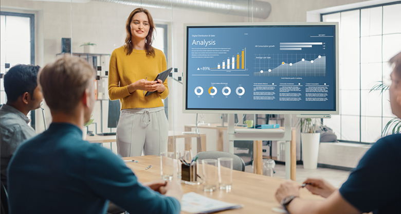 Young woman presenting analytical data to business owners