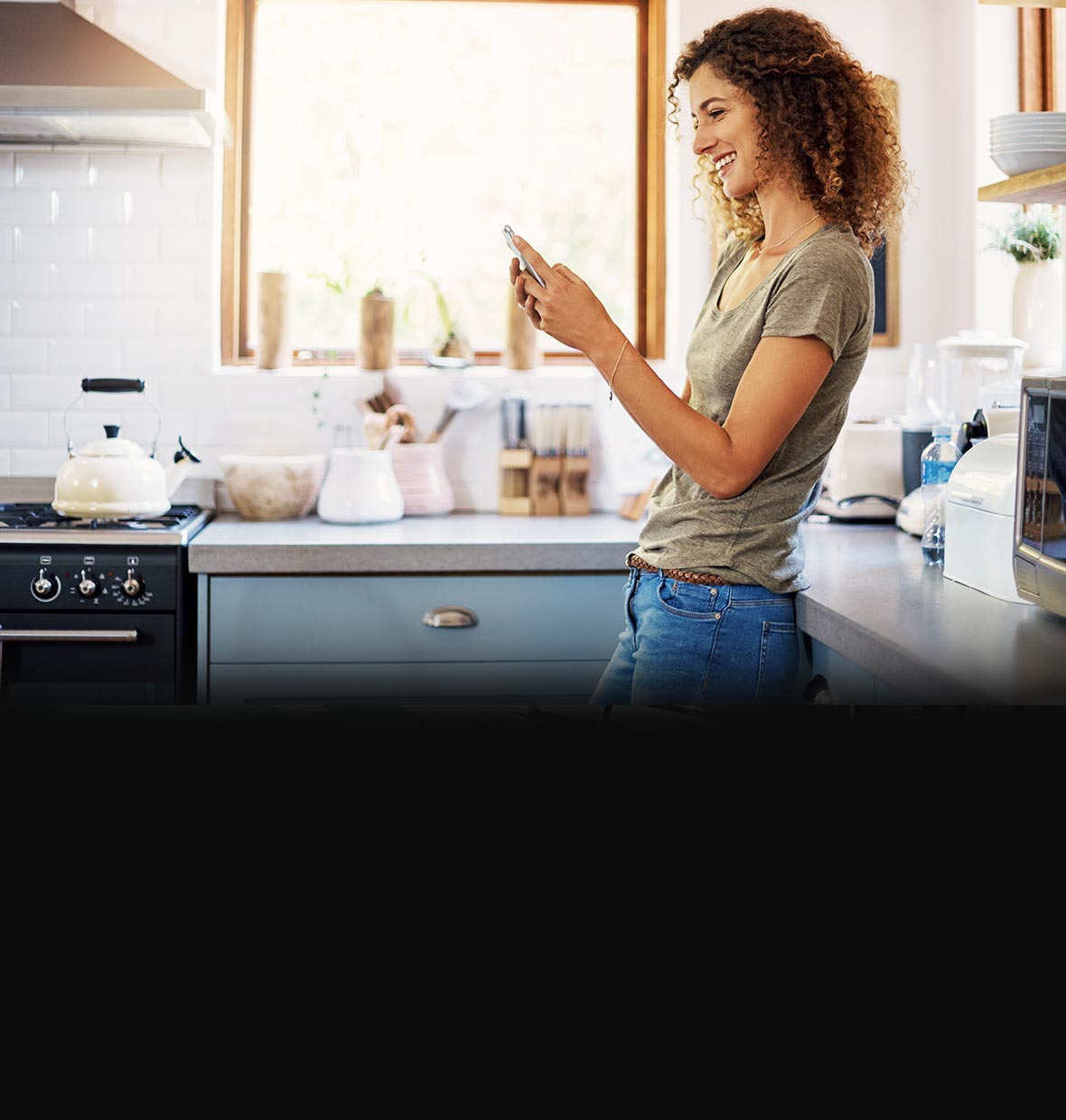 woman on mobile phone in kitchen