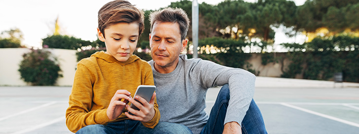 Father and son using the Youthapp