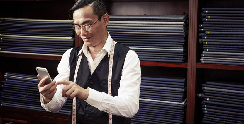 Tailor man with tape measure and calculator