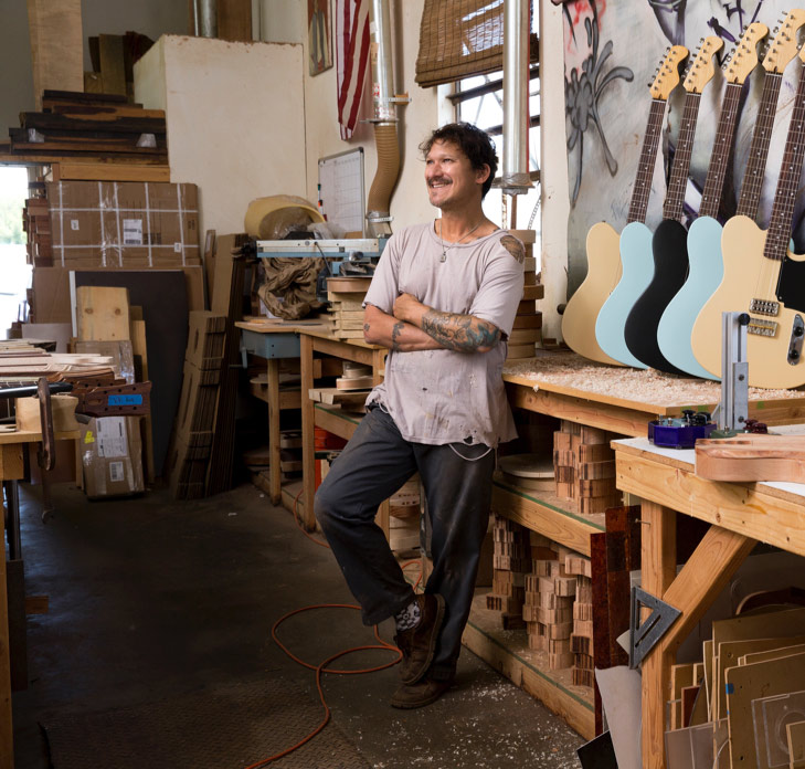 man in guitar factory