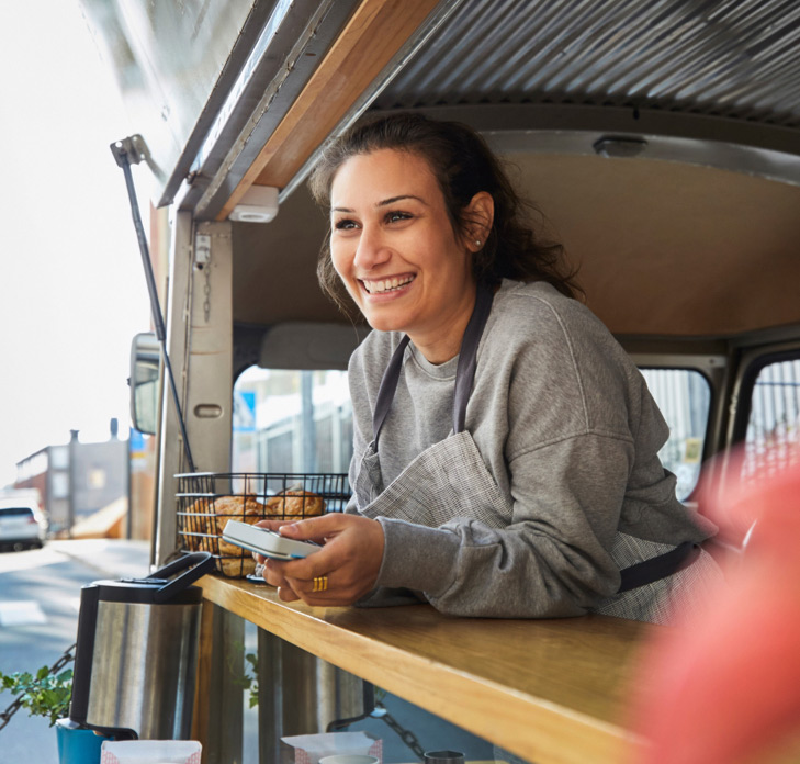 Woman working at coffee van