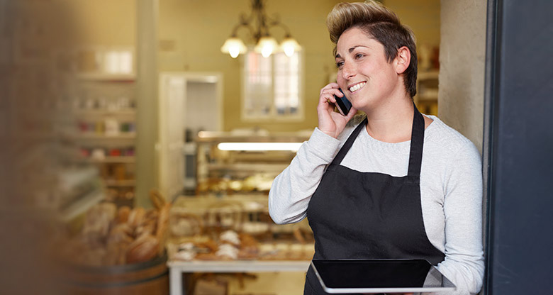 Bakery worker on phone