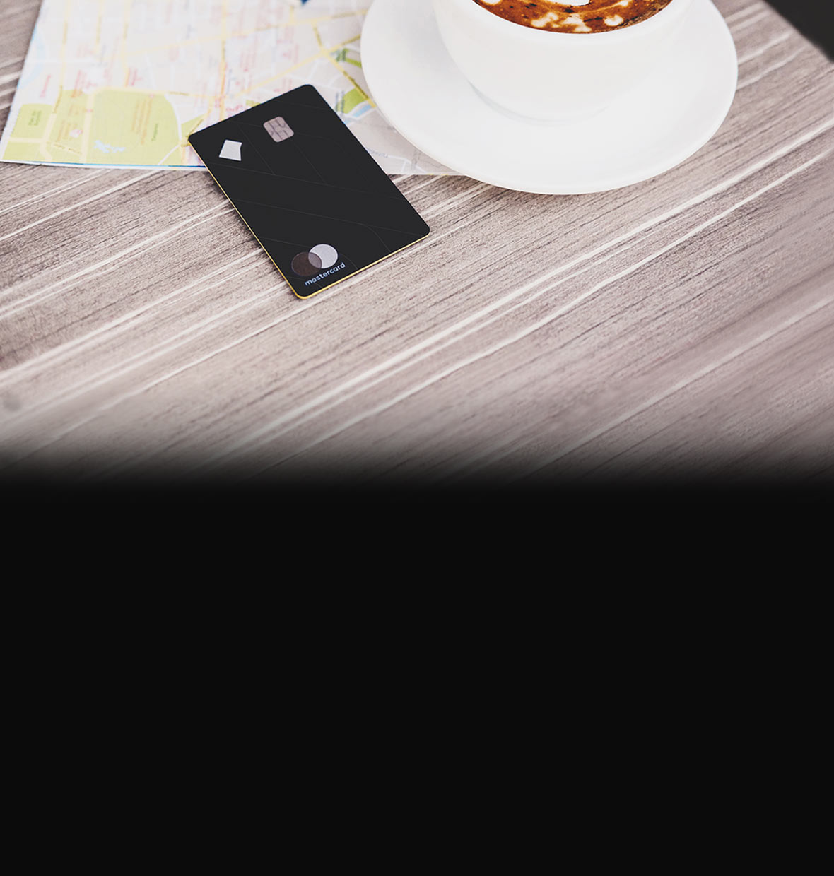 Ultimate Awards credit card on table with cup of coffee
