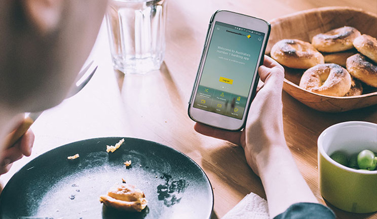Person looking at CommBank app on phone