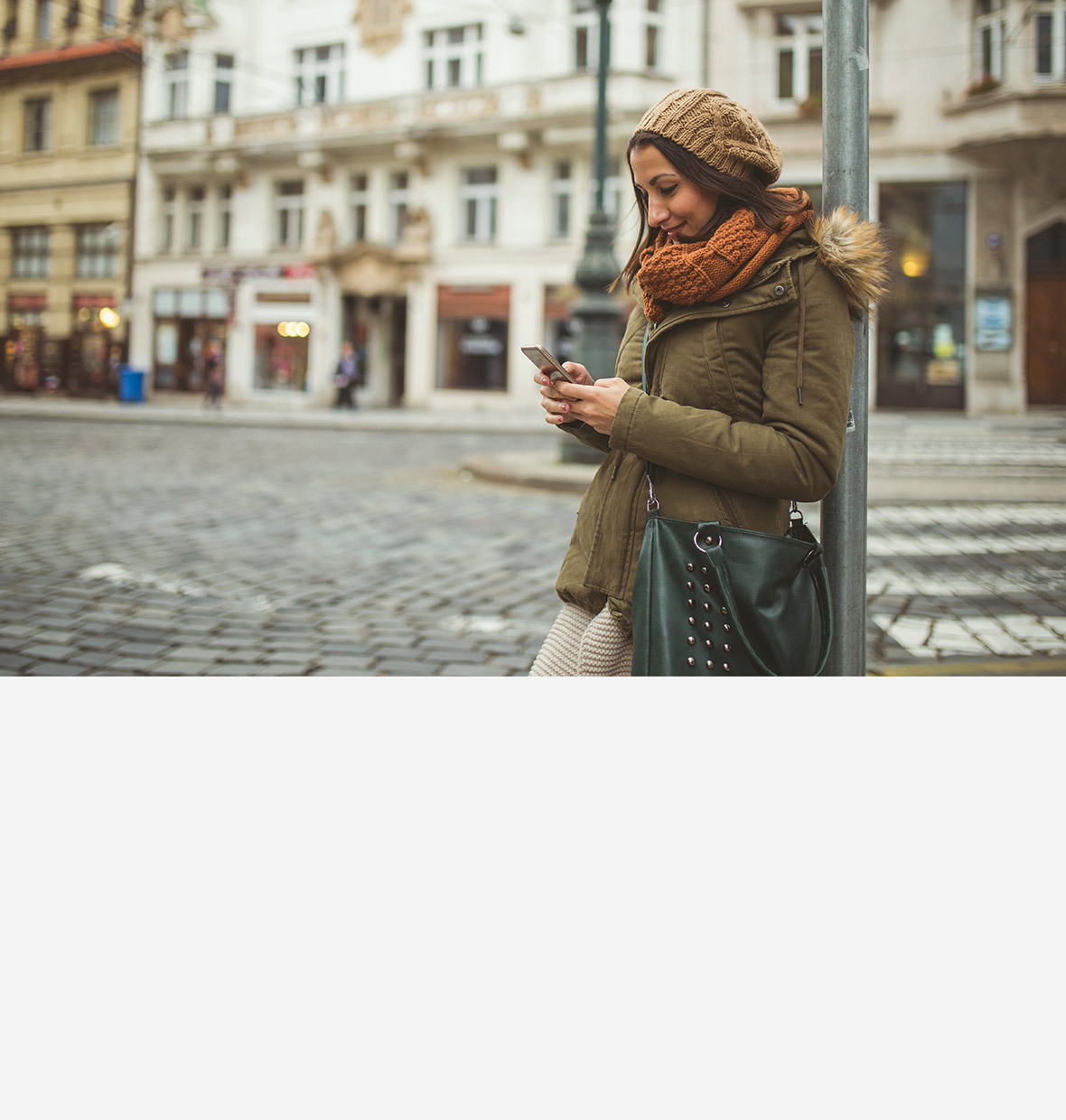 Girl travelling and looking at her phone