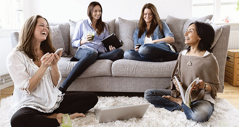 Group of women sitting together in living room