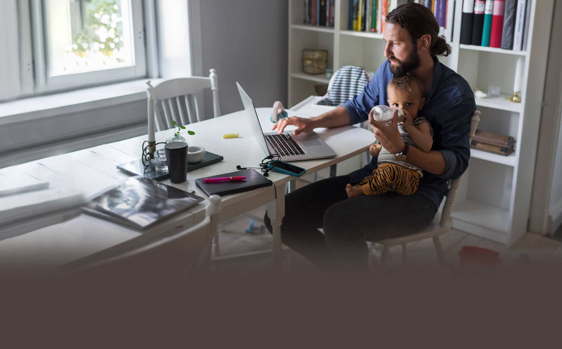 Man working at desk with baby