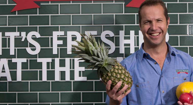 angus harris holding a pineapple