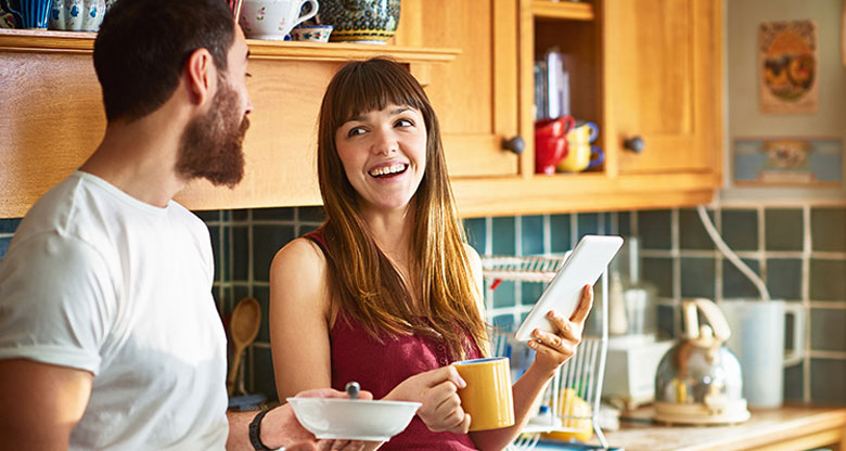 couple in kitchen with coffee