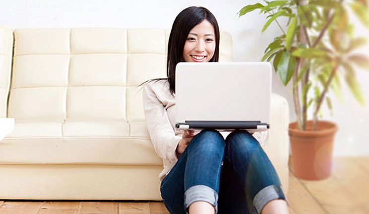 Lady on laptop sitting on floor