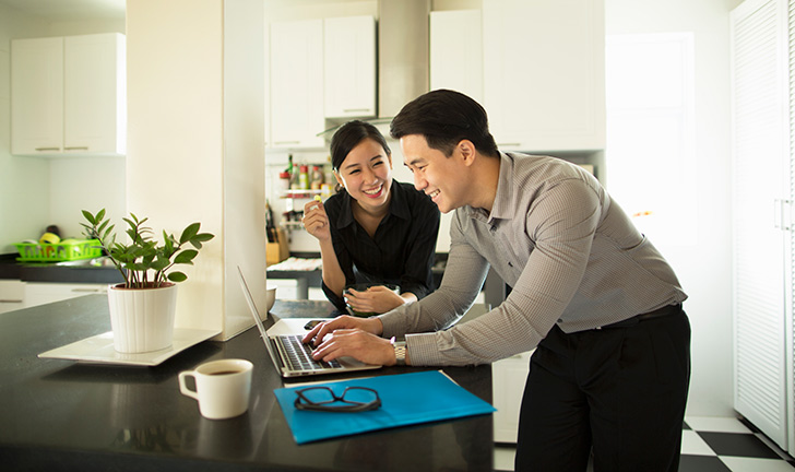 A CommBank Home Lending Specialist with his client