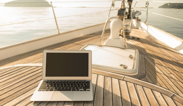 Photo of a laptop on the deck of a boat