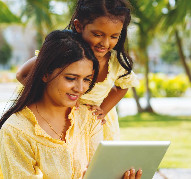 Mother and daughter looking at tablet device