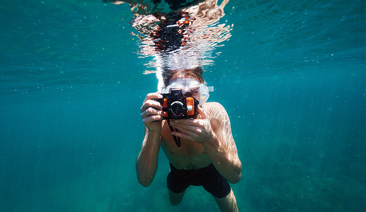Swimmer with underwater camera