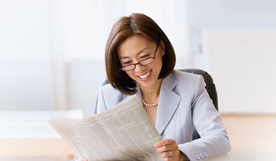 Female with Newspaper