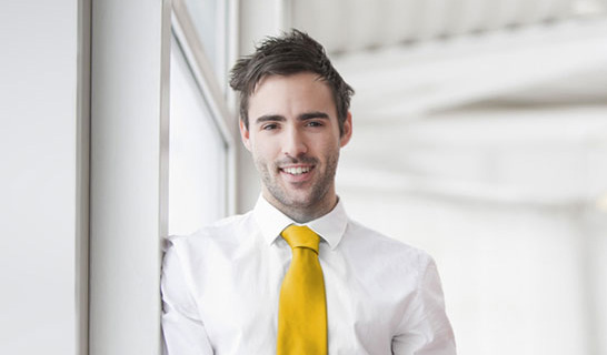 Man in white shirt and yellow tie