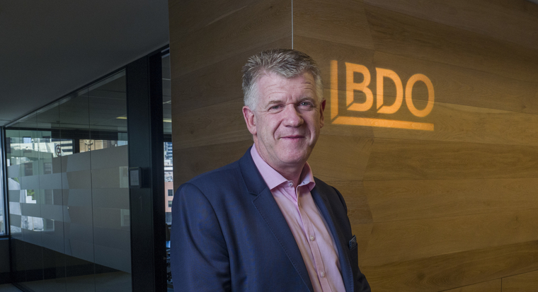 Grant Saxon in the BDO office