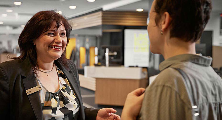 Image of CommBank staff member serving customer