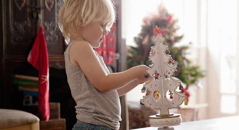 Child with Christmas decorations