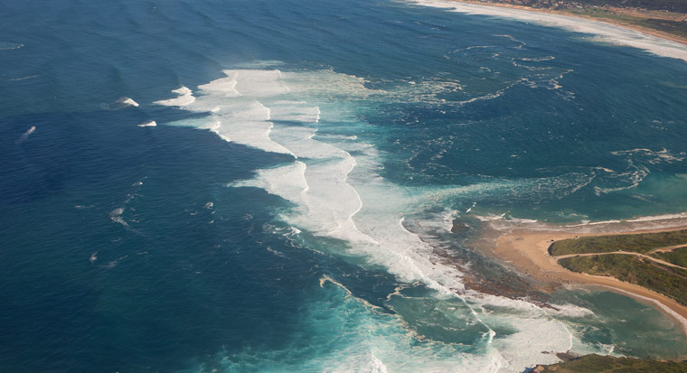aerial view of pounding surf on a beach