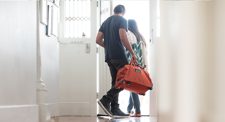 Couple leaving home for a holiday