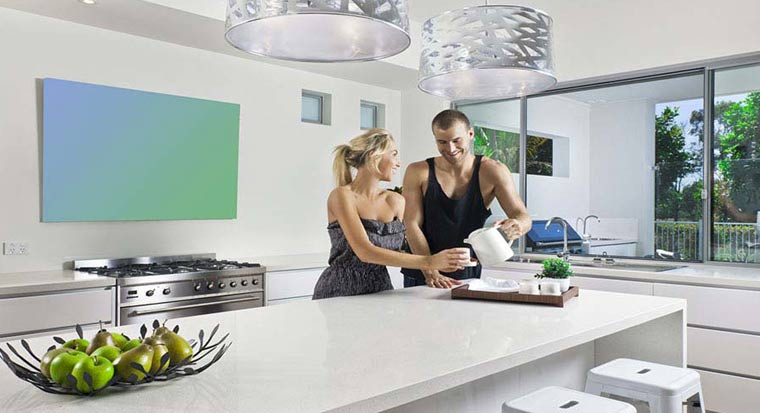Couple in kitchen of modern home