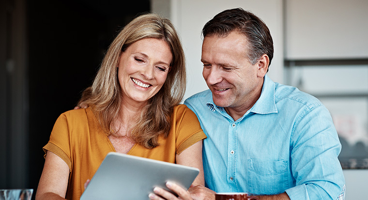 couple looking at tablet computer device