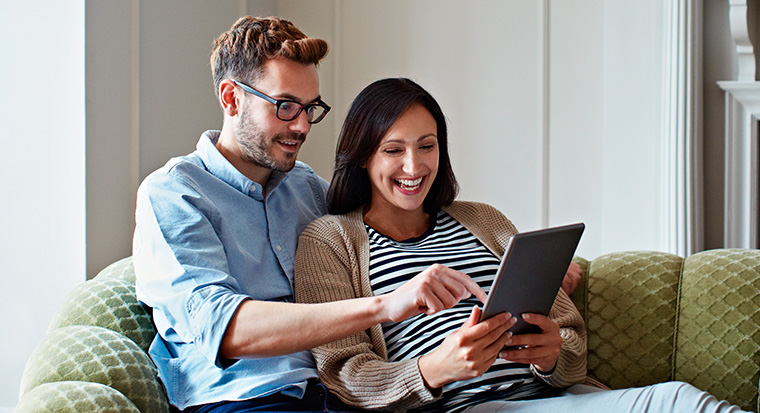 Image of a couple on the couch on a tablet