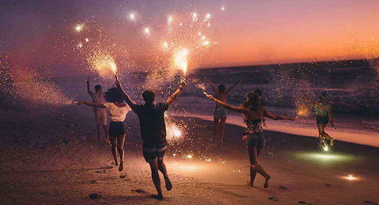 Celebrating New Year on the beach with fireworks