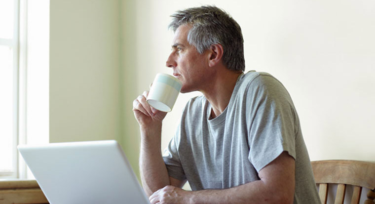 Image of man sitting at laptop
