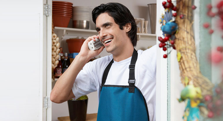 Male small business owner on phone