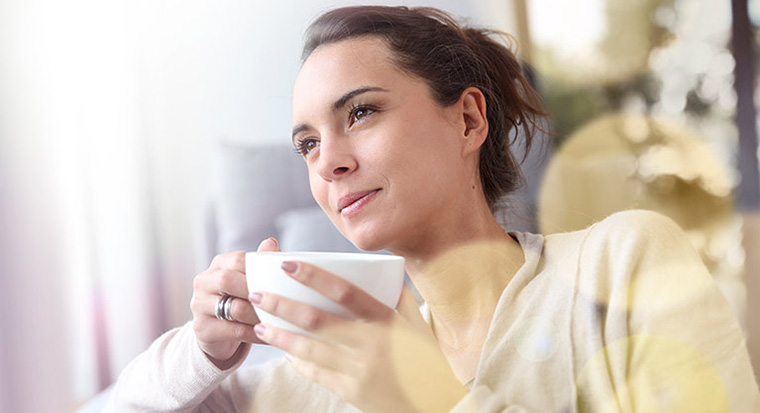 Woman drinking a mug of coffee