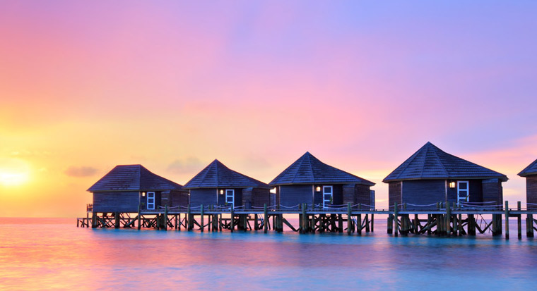 Huts on the beach with sunset