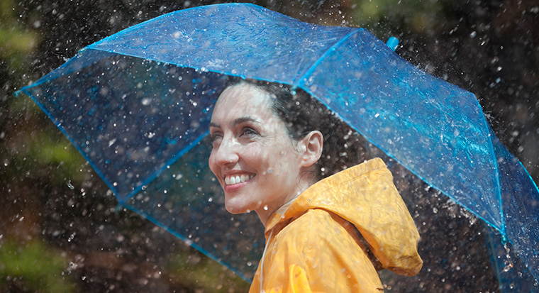 Image of woman holding umbrella