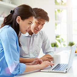 Image of couple researching home loan guides