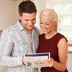 A couple researching home loan guides