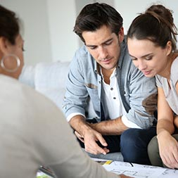 Image of young couple talking to a Home Lending Specialist