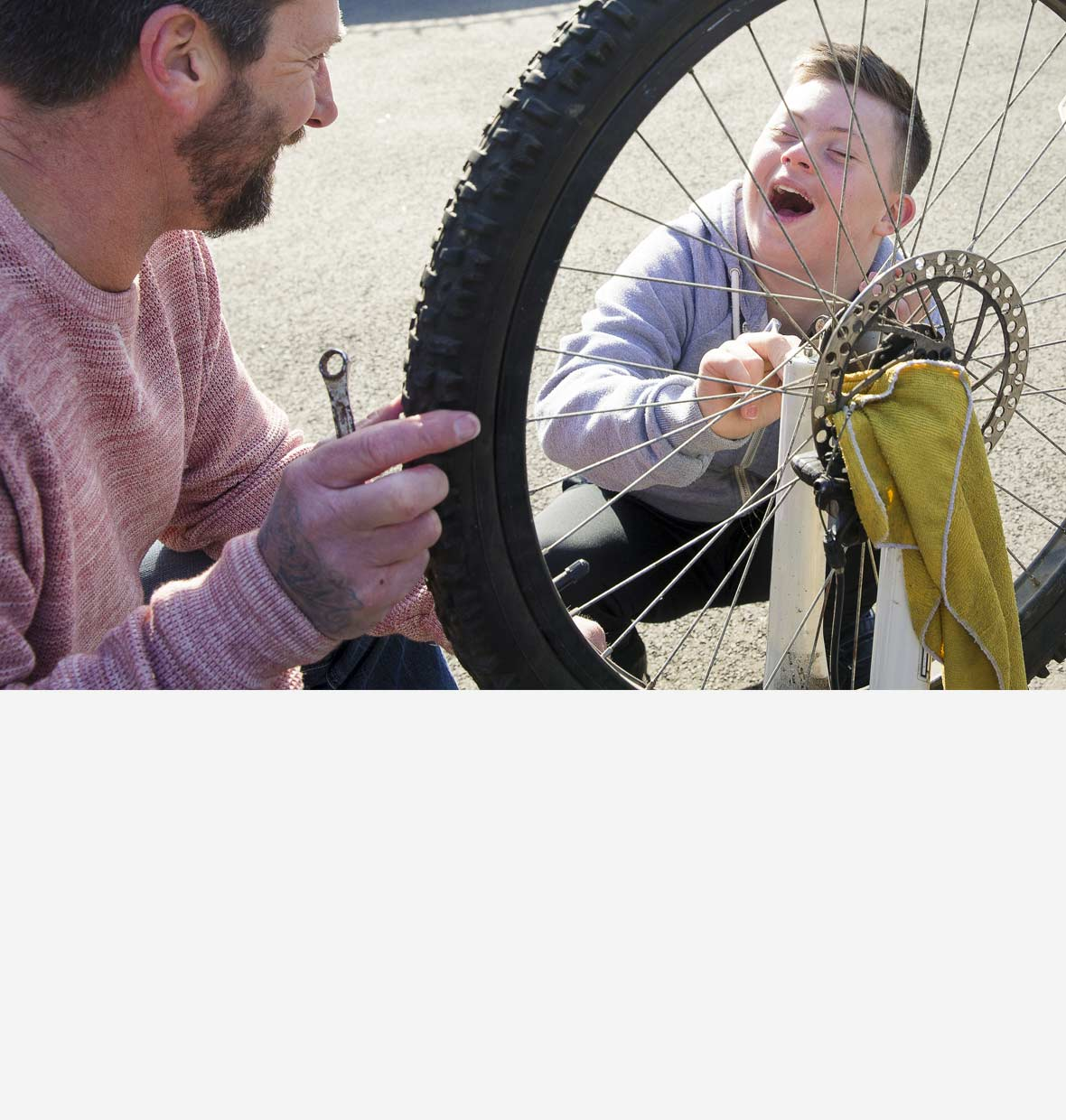 Dad and son fixing a bicycle