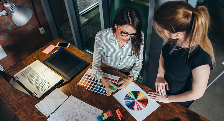 Creative female designers choosing colour palette